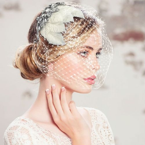 vintage inspired bridal headpiece with birdcage veil crystal